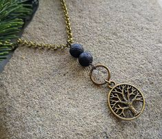 This Tree of Life essential oil necklace is a pretty way to wear your essential oils! Choose your length of antique bronze chain.