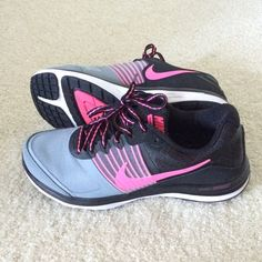 Nike tennis shoes Worn maybe twice inside. They are in perfect condition! Black, pink and gray Nikes. Size 6. Nike Shoes Athletic Shoes
