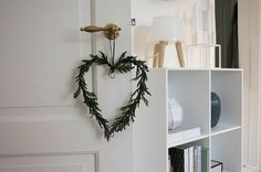 That Nordic Feeling of Denmark used metal hearts and fresh evergreen boughs to create delicious-smelling decorations.