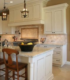 Applied Molding Off-White kitchen Cabinets with Chocklate glaze.  Marble Top