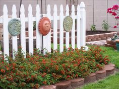 RMS user mike15619 uses a white fence to divide up his garden. The lantana bush blooms during the summer and he also grows onions, bell peppers and hot peppers. The sun collectibles finish the garden's cheerful look.