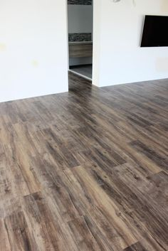 Nucore smoked walnut wide hand scraped plank with cork for Coreluxe engineered vinyl plank installation