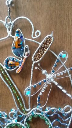 Wire wrapped beaded sun catcher with butterfly and dragonfly cat tail
