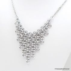 A sexy chainmaille necklace to wear with all of your low cut V necklines. This necklace would also look quite remarkable over a higher neckline as a focal piece. The necklace was handwoven, one ring a
