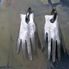 Frida earrings. These earrings are modeled after her famous hand earrings that Picasso made for her.