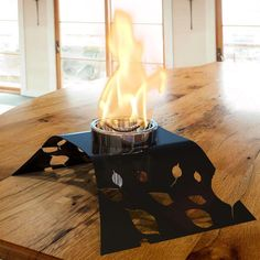 The DecorPro Aspen Indoor / Outdoor Fireburner is a design of natural beauty. It has a black epoxy powder coated solid steel base that matches the pattern of plant leaves and flowers. The DecorPro Aspen Indoor Fireburner has a fuel can that is centrally located inside its Chrome Finish Cup. The enchanting, glowing fire emanates from within. Tabletop Fireplaces, Ethanol Fireplace, Fireplace Mantels, Mantel Shelf, Patio Heater, Indoor Outdoor, Outdoor Decor, Electric Fireplace, Chrome Finish