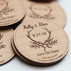 "Not a fan of paper save the dates? More and more couples are looking for ""useful"" versions of this announcement — like a magnet. This wooden magnet suggests a rustic wedding theme with the antler and branch motif."