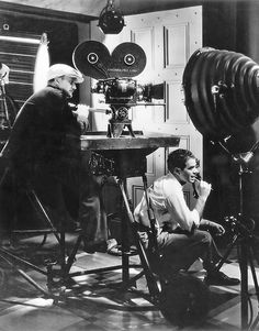 Frank Capra (right) with cinematographer Joe Walker at Columbia Studios. Walker photographed twenty of Capra's films including It Happened One Night, Mr. Smith Goes to Washington and It's a Wonderful Life