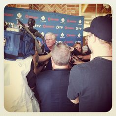 Brian Burke speaks with the media at the golf classic.