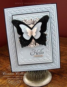 Elementry Elegance set, Beautiful Butterflies die and Beautiful Wings embosslit. It is difficult to see all the bling, but I covered the largest butterfly in Fine Galaxy Black Glitter. I also added some rhinestones for even more glitz. I used the Framed Tulips embossing folder.