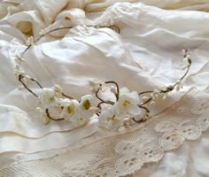 delicate white/ivory floral head wreath by Etsy seller thehoneycomb.