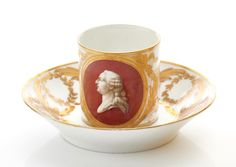 A Hard-Paste Sèvres Porcelain Cup with portrait of Louis XVI and later saucer, circa 1775
