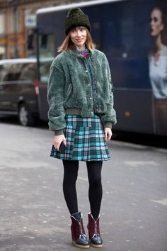 bomber jackets are sporty paired with a cute skirt and booties makes it a more sophisticated look Paris Street Style Fall 2014