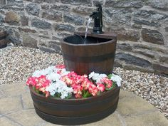 Stretton Oak Tubs water feature with planter. Pretty!
