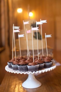 Cute little flags give height to shorter stands/plates in cupcake display