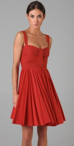 Girls with thinner arms can really pull off tank dresses well. This warm red looks like it was made for this model and her complexion.
