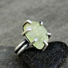 natural green aquamarine slice with super chunky prongs.