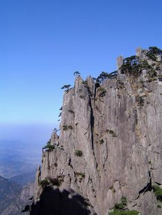 spectacular rock outcrop dotted with pine trees in the Yellow mountains, China - free stock photo from www.freeimages.co.uk