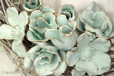 artificial flowers dipped in plaster of paris .. let dry hanging from dowel stick in plastic clothes bsket ...these could look beautiful in bowl ...stick with white or cream colored articial flowers... others may bleed into plaster mix.
