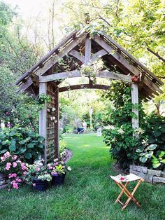 An arbor serves as a beautiful portal to a backyard garden. This large arbor features posts that are 6x6 lumber--large enough to support any climbing plant. The lattice sides and top provide crawling space for flowering climbers such as roses or clematis.