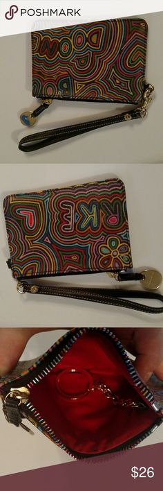 "Dooney & Bourke small doodle wristlet Excellent condition! Beautiful colors! This is basically like new condition. Measurements are approx 5.5x4"" Dooney & Bourke Bags Clutches & Wristlets"