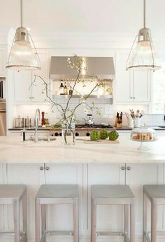 love the crisp clean color, great lighting, and stove hood, and countertop
