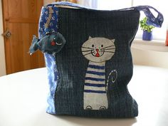 Painted cat on handmade denim bag. Very cute and looks easy enough to do. Who cares if there's no pattern.
