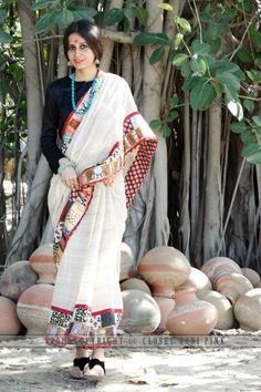 CR139219 - Ivory color linen saree. Border has zary patch work & block print patch work in all over 9 yards. 1 meter palla has multi color patti detailing. Facing is in maroon block print.