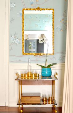 A bar cart vignette designed by Charlotte Lucas. Click through to see more of Lucas's work in our March 2015 issue! | Lonny.com
