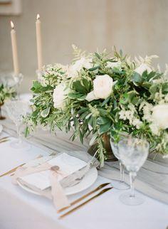 Organic olive branch + rose centerpiece: http://www.stylemepretty.com/2016/07/25/white-on-white-greek-wedding-inspiration/ | Photography: Vasia Photography - http://www.vasia-weddings.com/