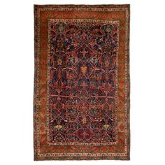 An ornate garden-themed pattern of poppy flowers, stylized leaves, and angular branches is a hallmark of this Persian Bijar wool rug. Floral and classical motifs depict Persian and Kurdish influences, while a rich, jewel-toned palette renders these antiques among the finest and most sought-after styles. Distinguished primarily by their dense, durable weave, Bijar carpets today represent the skill, artistry, and age-old craftsmanship that characterize the Persian weaving tradition.