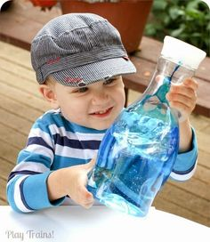 http://play-trains.com/two-color-oil-and-water-discovery-bottles/