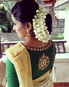 Elegantly crafted designer blouse for our beautiful bride. AanDe by Aanu Nobby 👗fashion designer Kerala Saree Blouse Designs, Fancy Blouse Designs, Bridal Blouse Designs, Blouse Neck Designs, Lehenga Designs, Designer Blouse Patterns, Saree Blouse Patterns, Set Saree, Saree Dress