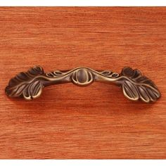 This antique english finish standard size cabinet pull with two leaf ends design from RK International is perfect for use on cabinet doors and drawers capable of accepting a mounted pull.