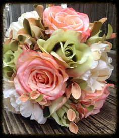 "This is a stunning bridal bouquet!! Perfect for the season. It boasts three large 4"" blooming blush roses, three 4.5"" blossoming ivory peonies, and three 3"" budding green roses blossoms. Along with th"