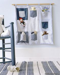 Cute wall hanging made of old t-shirt pockets.