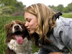 They dip their noses into all sorts of unsavoury places – but smooching your pet dog could actually be good for your health.