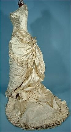c. 1882 Wedding Bustle Gown of Ivory Satin with Pearls and Silk Confetti Fringe