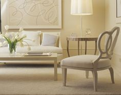 A beautiful transitional neutral living room that's stands out with the texture…