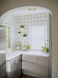 "Earlier this year, I toyed around with tiling our ""breakfast nook"" and got as far as ordering samples. I envisioned a pistachio green wall for that retro flare to match our KitchenAid appliances. Fast forward 4 months: I finally did something about it, but not in the way you'd expect! I used the tile stencil and paint I got for a future bathroom project. Buy Curtains, Reclaimed Doors, Wood Accent Wall, Furniture Makeover, Tile Backsplash, Stencil Furniture, Rustic Backsplash, Faux Brick Backsplash, Outdoor Sheer Curtain"
