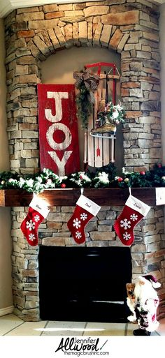 "A beautiful ""Joy"" sign on repurposed barnwood. It's very easy painted DIY project that makes for simple, poignant Christmas décor for your fireplace mantel. More painting tips at theMagicBrushinc.com"