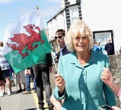 Camilla Parker Bowles Photos - Camilla, Duchess of Cornwall waves a Welsh flag during a visit to the Welsh Village on July 5, 2016 in Aberdaron, England. The Prince Charles, Prince of Wales and Camilla, Duchess of Cornwall are on the second day of their annual visit to Wales. - Prince Of Wales & Duchess Of Cornwall's Annual Summer Visit To Wales