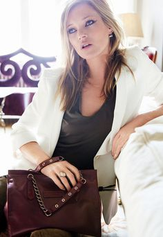 Kate Moss for #Longchamp. Winged liner, white blazer, #olive shirt, studded brown bag... the colors!
