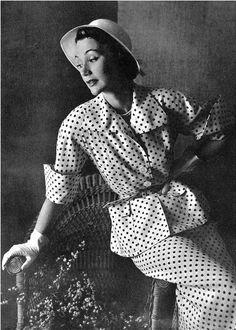 1949 Sophie Malgat in elegant summer suit of white and navy polka-dots, worn with small white Panama hat, by Jeanne Lanvin, photo by Pottier,