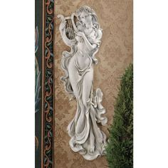 Infuse your space with inspiration with the Design Toscano Musical Muse Wall Sculpture. Although she is cast in a solidly durable material with a stone finish, her robes appear to float about her. Wall Sculptures, Sculpture Art, Muse Of Music, Crushed Stone, Wall Decor Set, Music Decor, Decoration, Gallery Wall, Antiques