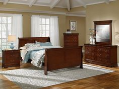 New Elegance. The simple, sturdy lines and dark wood of Louis Philippe-style furnishings are brought to bear in our Neo Classic Cherry collection. Presented in a warm finish, these pieces feature classic touches like antiqued drop-bail hardware and a sleigh bed design. The nightstand, dresser and chest all contain at least one hidden,