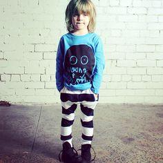 Minti raising the monkey bar on playground fashion