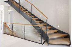 HPL thin-walled staircase with wooden steps by Treppenbau VOß