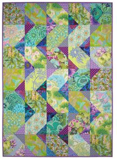 """Cascade"" by SpringLeaf Studios. The quilt features fabrics from Kaffe Fassett and Michael Miller"