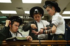 Helping his friend wrap Tefillin